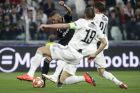 Ajax's Hakim Ziyech is challenged by Juventus' Leonardo Bonucci and Daniele Rugani during the Champions League, quarterfinal, second leg soccer match between Juventus and Ajax, at the Allianz stadium in Turin, Italy, Tuesday, April 16, 2019. (AP Photo/Luca Bruno)