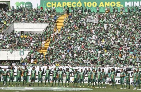 The new Chapecoense team stands at the field prior to a friendly match against Palmeiras, in Chapeco, Brazil, Saturday, Jan. 21, 2017. Almost two months after the air tragedy that killed 71 people, including 19 team players, Chapecoense plays at its Arena Conda stadium against the 2016 Brazilian champion Palmeiras. (AP Photo/Andre Penner)