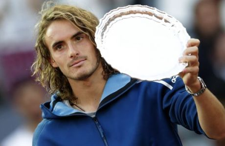 Greece's Stefanos Tsitsipas hold the runner-up trophy after losing the final of the Madrid Open tennis tournament against Serbia's Novak Djokovic in Madrid, Spain, Sunday, May 12, 2019. (AP Photo/Bernat Armangue)