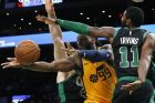 Utah Jazz's Jae Crowder (99) passes the ball against Boston Celtics' Kyrie Irving (11) during the first half on an NBA basketball game in Boston, Saturday, Nov. 17, 2018. (AP Photo/Michael Dwyer)