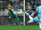 Udinese goalkeeper Orestis Karnezis, left, saves on Lazio's Sergej Milinkovic-Savic, during the Serie A soccer match between Udinese and Lazio at the Friuli Stadium in Udine, Italy, Sunday, Jan. 31, 2016. (AP Photo/Paolo Giovannini)
