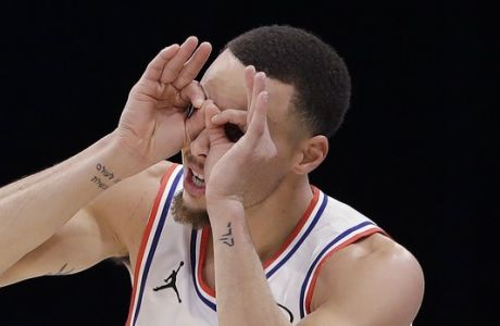 CORRECTS TO THE WARRIORS, NOT THE BUCKS - Team Giannis' Stephen Curry, of the Golden State Warriors celebrates his three-point shot against Team LeBron during the second half of an NBA All-Star basketball game, Sunday, Feb. 17, 2019, in Charlotte, N.C. The Team LeBron won 178-164. (AP Photo/Chuck Burton)