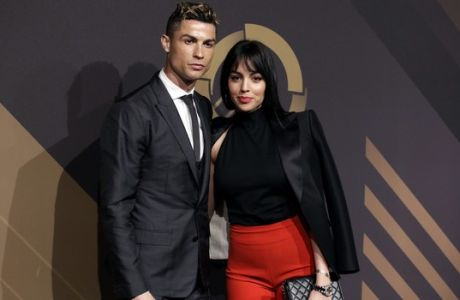 Real Madrid player Cristiano Ronaldo and his girlfriend Georgina Rodriguez pose for photos as they arrive for the Portuguese soccer federation awards ceremony Monday, March 19, 2018, in Lisbon. (AP Photo/Armando Franca)