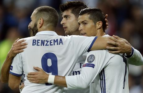Real Madrid's Alvaro Morata, center, celebrates with Cristiano Ronaldo, right, and Karim Benzema after scoring his side's fifth goal during a Champions League, Group F soccer match between Real Madrid and Legia Warsaw, at the Santiago Bernabeu stadium in Madrid, Tuesday, Oct. 18, 2016. (AP Photo/Francisco Seco)