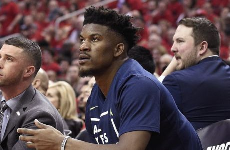 Minnesota Timberwolves guard Jimmy Butler, right, watches from the bench during the second half in Game 5 of the team's first-round NBA basketball playoff series against the Houston Rockets, Wednesday, April 25, 2018, in Houston. (AP Photo/Eric Christian Smith)