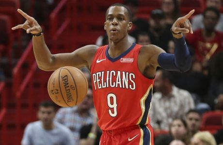 New Orleans Pelicans guard Rajon Rondo (9) calls a signal as he brings the ball up court against the Miami Heat during the first half of an NBA basketball game, Saturday, Dec. 23, 2017, in Miami. (AP Photo/Joel Auerbach)