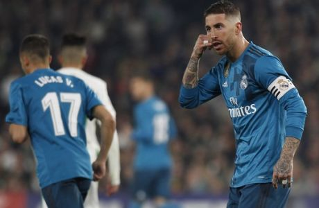 Real Madrid's Sergio Ramos, reacts after scoring against Betis during La Liga soccer match between Betis and Real Madrid at the Villamarin stadium, in Seville, Spain on Sunday, Feb. 18, 2018. (AP Photo/Miguel Morenatti)