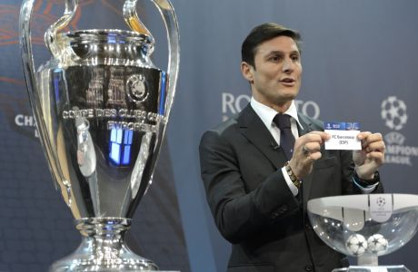 Former Italian soccer player Javier Zanetti, ambassador for the UEFA Champions League final in Milan,  shows the  ticket of FC Barcelona during the draw of the 2015/16  Champions League Round of 16 at the UEFA Headquarters in Nyon, Switzerland, Monday, Dec. 14, 2015.  (Laurent Gillieron/Keystone via AP)