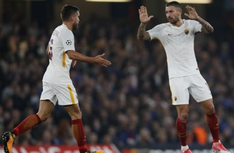 Roma's Aleksandar Kolarov, right, celebrates with his teammate Kevin Strootman, after scoring during the Champions League group C soccer match between Chelsea and Roma at Stamford Bridge stadium in London, Wednesday, Oct. 18, 2017. (AP Photo/Kirsty Wigglesworth)
