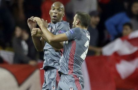 Besiktas' Cenk Tosun, right, celebrates scoring his 2nd goal with his teammate Ryan Babel during the Champions League Group G first leg soccer match between Monaco and Besiktas at Louis II stadium in Monaco, Tuesday, Oct. 17, 2017. (AP Photo/Claude Paris)