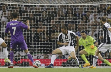 Real Madrid's Cristiano Ronaldo scores during the Champions League final soccer match between Juventus and Real Madrid at the Millennium Stadium in Cardiff, Wales, Saturday June 3, 2017. (AP Photo/Tim Ireland)