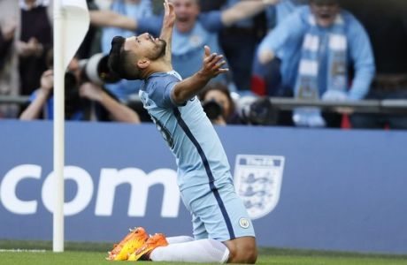 Manchester City's Sergio Aguero celebrates after scoring the opening goal during the English FA Cup semifinal soccer match between Arsenal and Manchester City at Wembley stadium in London, Sunday, April 23, 2017. (AP Photo/Kirsty Wigglesworth)