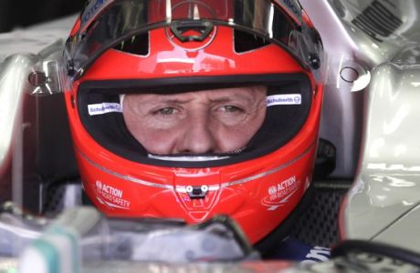 FILE - In this Nov. 23, 2012 file photo, Grand Prix driver Michael Schumacher, of Germany, sits in his car during a free practice at the Interlagos race track in Sao Paulo, Brazil.  Formula One great Michael Schumacher is no longer in a coma and has left a French hospital where he had been receiving treatment since a skiing accident in December, his manager said Monday June 16, 2014. (AP Photo/Victor Caivano, File)
