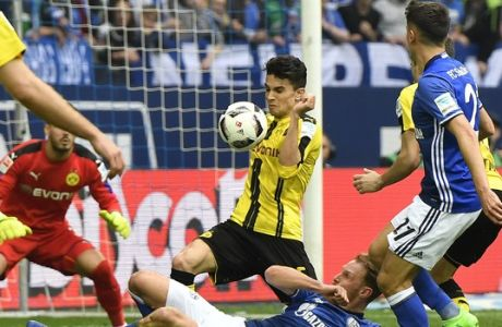 Dortmund's Marc Bartra touches the ball with his arm during the German Bundesliga soccer match between FC Schalke 04 and Borussia Dortmund in Gelsenkirchen, Germany, Saturday, April 1, 2017. (AP Photo/Martin Meissner)