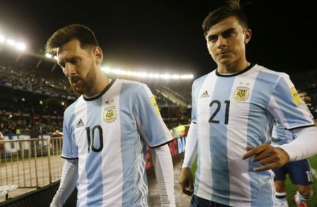 Argentina's Lionel Messi , left, and his teammate Paulo Dybala leave the field at the half time during a 2018 World Cup qualifying soccer match against Venezuela in Buenos Aires, Argentina, Tuesday, Sept. 5, 2017. (AP Photo/Victor R. Caivano)