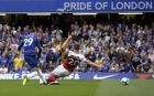 Chelsea's Alvaro Morata, left, scores his side's second goal during the English Premier League soccer match between Chelsea and Arsenal at Stamford bridge stadium in London, Saturday, Aug. 18, 2018. (AP Photo/Tim Ireland)