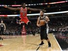 Chicago Bulls forward Justin Holiday (7) defends San Antonio Spurs guard Marco Belinelli (18) during the second half of an NBA basketball game Monday, Nov. 26, 2018, in Chicago. The Spurs won 108-107. (AP Photo/David Banks)
