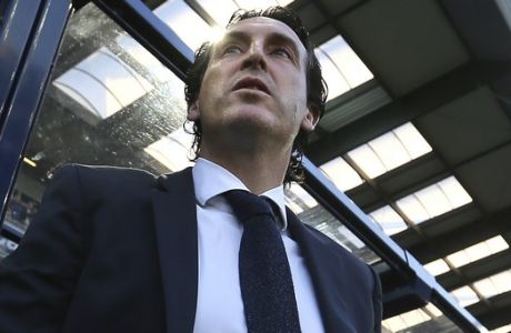 PSG head coach Unai Emery looks on at the start of his League One soccer match between Caen and Paris Saint-Germain at the Michel d'Ornano stadium in Caen, western France, Saturday, May 19, 2018. This is his last match with the PSG team. German coach Thomas Tuchel will replace him for the next season. (AP Photo/David Vincent)