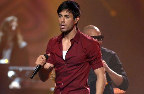 FILE - In this Nov. 9, 2014 file photo, Enrique Iglesias performs during the 2014 MTV European Music Awards in Glasgow. Universal Music Latin Entertainment announced Monday, July 13, 2015, the first edition of L Festival-Feria Cultural Latinoamericana, an art, gastronomy and music event that will take place October 24-24 at the OC Fair & Event Center, featuring Enrique Iglesias and Juan Gabriel. (Photo by Joel Ryan/Invision/AP, File)