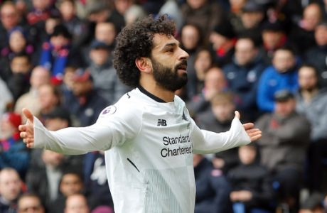 FILE - In this Saturday, March, 31, 2018 file photo, Liverpool's Mohamed Salah celebrates scoring his side's second goal of the game during their English Premier League soccer match against Crystal Palace at Selhurst Park stadium in London. Manchester City midfielder Kevin De Bruyne and Liverpool forward Mohamed Salah are English soccers two standout stars this season and are going head to head for the countrys Player of the Year award. For many its too close to call as to who has had the better season so maybe the two-legged Champions League quarterfinal matchup between Liverpool and City starting Wednesday, April 4 will settle the argument. (AP Photo/Alastair Grant, file)