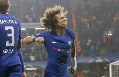 Chelsea's David Luiz, right, celebrates after scoring during the Champions League group C soccer match between Chelsea and Roma at Stamford Bridge stadium in London, Wednesday, Oct. 18, 2017. (AP Photo/Frank Augstein)