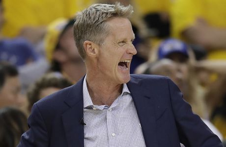 Golden State Warriors head coach Steve Kerr smiles during the first half of Game 5 of basketball's NBA Finals between the Warriors and the Cleveland Cavaliers in Oakland, Calif., Monday, June 12, 2017. (AP Photo/Marcio Jose Sanchez)