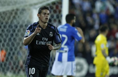 Real Madrid's James Rodriguez celebrates after scoring the opening goal against Leganes during a Spanish La Liga soccer match between Leganes and Real Madrid at the Butarque stadium in Madrid, Wednesday, April 5, 2017. (AP Photo/Francisco Seco)