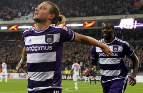 Anderlecht's Guillaume Gillet, left, and teammate Stefano Okaka jubilate after scoring a goal during a UEFA Europa League soccer, Group stage, match between RSC Anderlecht and AS Monaco FC at the Constant Vanden Stock Stadium in Brussels on Thursday, Sept. 17, 2015. (AP Photo/Francois Walschaerts)