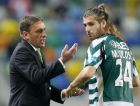 Sporting coach Paulo Bento (L) gives instructions to his player Miguel Veloso during the match against Benfica in their Portuguese Premier League soccer match at Alvalade stadium in Lisbon March 2, 2008. REUTERS/Marcos Borga (PORTUGAL)