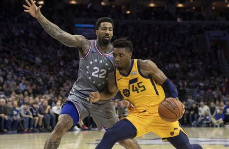 Utah Jazz's Donovan Mitchell, right, makes his move on Philadelphia 76ers' Wilson Chandler, left, during the second half of an NBA basketball game, Friday, Nov. 16, 2018, in Philadelphia. (AP Photo/Chris Szagola)