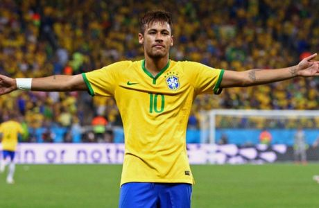 SAO PAULO, BRAZIL - JUNE 12:  Neymar of Brazil celebrates after scoring his second goal on a penalty kick in the second half during the 2014 FIFA World Cup Brazil Group A match between Brazil and Croatia at Arena de Sao Paulo on June 12, 2014 in Sao Paulo, Brazil.  (Photo by Adam Pretty/Getty Images)