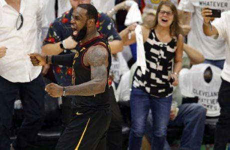 Cleveland Cavaliers' LeBron James reacts after making a 3point shot during the second half of Game 6 of the team's NBA basketball Eastern Conference finals against the Boston Celtics, Friday, May 25, 2018, in Cleveland. The Cavaliers won 109-99. (AP Photo/Ron Schwane)