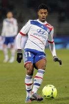 Lyon's Michel Bastos, of Brazil, controls the ball during their French League One soccer match against Nancy at Gerland stadium, in Lyon, central France, Wednesday, Dec. 12, 2012. (AP Photo/Laurent Cipriani)