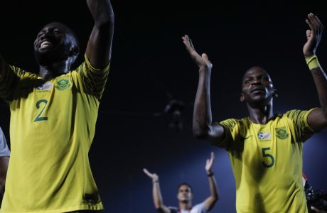 South African players celebrate after the African Cup of Nations round of 16 soccer match between Egypt and South Africa in Cairo International stadium in Cairo, Egypt, Saturday, July 6, 2019. (AP Photo/Ariel Schalit)