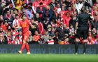 Liverpool's Luis Suarez, left, speaks to referee Phil Dowd after having his goal scored from a free kick disallowed during their English Premier League soccer match against Newcastle United at Anfield in Liverpool, England, Sunday May 11, 2014. (AP Photo/Clint Hughes)