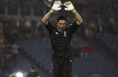 Juventus goalkeeper Gianluigi Buffon warms-up prior to the Italian Cup final soccer match between Juventus and AC Milan, at the Rome Olympic stadium, Wednesday, May 9, 2018. (AP Photo/Gregorio Borgia)