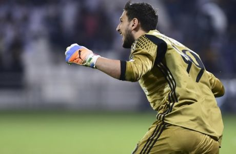 AC Milan goalkeeper Gianluigi Donnarumma celebrates at the end of the Italian Super Cup soccer match between Juventus and AC Milan, at the Al Sadd Sports Club in Doha, Qatar, Friday, Dec. 23, 2016. AC Milan won 5-4 following a shootout. (AP Photo/Alexandra Panagiotidou)