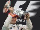 BMW Sauber Formula One driver Robert Kubica of Poland lifts his trophy after finishing second in the Malaysian Grand Prix at the Sepang Formula One circuit near Kuala Lumpur, Malaysia, Sunday, March 23, 2008. Ferrari Formula One driver Kimi Raikkonen of Finland won, McLaren Mercedes Formula One driver Heikki Kovalainen of Finland went into third place. (AP Photo/Oliver Multhaup)