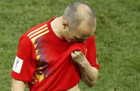 Spain's Andres Iniesta leaves the pitch after the round of 16 match between Spain and Russia at the 2018 soccer World Cup at the Luzhniki Stadium in Moscow, Russia, Sunday, July 1, 2018. Russia eliminates Spain 4-2 on penalties after game ends 1-1. (AP Photo/David Vincent)