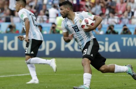 Argentina's Sergio Aguero, right, runs to midfield after scoring his side's third goal during the round of 16 match between France and Argentina, at the 2018 soccer World Cup at the Kazan Arena in Kazan, Russia, Thursday, June 28, 2018. (AP Photo/Ricardo Mazalan)