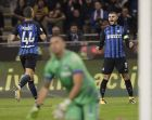 Inter's Mauro Icardi, right, celebrates after scoring second goal for his side during an Italian Serie A soccer match between Inter Milan and Sampdoria, at the San Siro stadium in Milan, Italy, Tuesday, Oct. 24, 2017. (AP Photo/Luca Bruno)