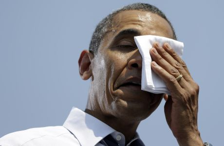 President Barack Obama wipes sweat from his face during a campaign event at Iowa State University, Tuesday, Aug. 28, 2012, in Ames, Iowa. (AP Photo/Pablo Martinez Monsivais)