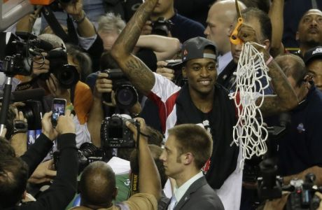 Louisville guard Kevin Ware holds the net after Louisville defeated Michigan 82-76 after the second half of the NCAA Final Four tournament college basketball championship game Tuesday, April 9, 2013, in Atlanta. (AP Photo/Chris O'Meara)