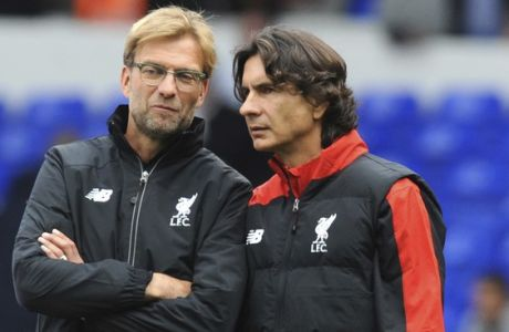 FILE - In this file photo dated Saturday, Oct. 17, 2015, Liverpool manager Juergen Klopp, left, talks with assistant manager Zeljko Buvac before their English Premier League soccer match against Tottenham Hotspur at the White Hart Lane in London. Liverpools assistant coach Buvac, is spending some time away from the team until the end of the season for personal reasons, it is announced Monday April 30, 2018, potentially disrupting the teams bid to qualify for the Champions League final this week. (AP Photo/Rui Vieira, FILE)