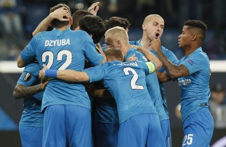 Zenit St.Petersburg's team players celebrates after scoring the opening goal during the Europa League round of 32 soccer match between Zenit St.Petersburg and Fenerbahce at the Saint Petersburg Stadium in St.Petersburg, Thursday, Feb. 21, 2019. (AP Photo/Dmitri Lovetsky)