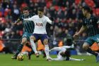 Tottenham Hotspur's Erik Lamela, centre, vies for the ball with Southampton's Pierre-Emile Hojbjerg, left, during their English Premier League soccer match between Tottenham Hotspur and Southampton at Wembley stadium in London, Tuesday, Dec. 26, 2017. (AP Photo/Alastair Grant)