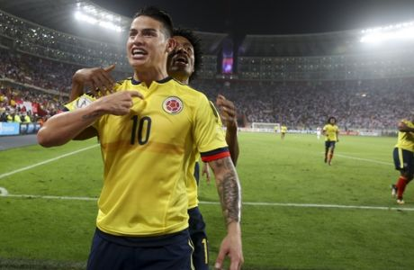 Colombia's James Rodriguez celebrates after scoring against Peru during a 2018 World Cup qualifying soccer match in Lima, Peru, Tuesday, Oct. 10, 2017. Behind Rodriguez is Colombia's Juan Cuadrado. (AP Photo/Martin Mejia)