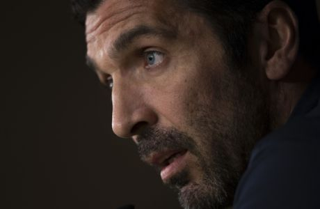 Juventus' goalkeeper Gianluigi Buffon answers a question during a news conference at the Santiago Bernabeu stadium in Madrid, Tuesday, April 10, 2018. Juventus will play a Champions League quarter final second leg soccer match with Real Madrid on Wednesday 11. (AP Photo/Francisco Seco)