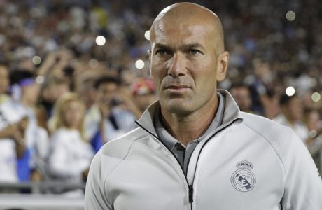 Real Madrid manager Zinedine Zidane walks across the field before the team's International Champions Cup soccer match against the Manchester City Wednesday, July 26, 2017, in Los Angeles. (AP Photo/Jae C. Hong)