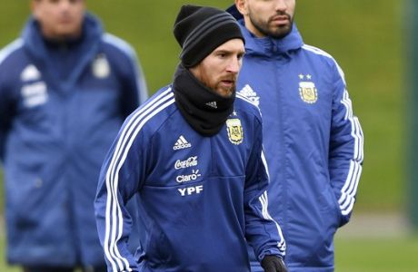 Argentina's Sergio Aguero, right, and Lionel Messi attends a training session at the City Football Academy, in Manchester, England, Tuesday March 20, 2018. Argentina will play Italy in an international friendly on Friday. (Dave Howarth//PA via AP)